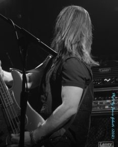 Fozzy bassist Paul Di Leo on stage at London's Electric Ballroom December 2012