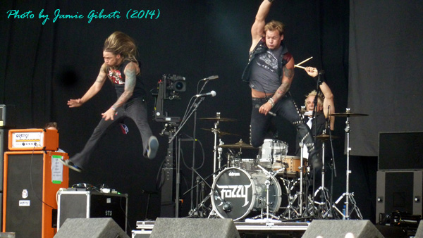 Rich & Chris from Fozzy jumping off the drumkit on stage at Download Festival 2014