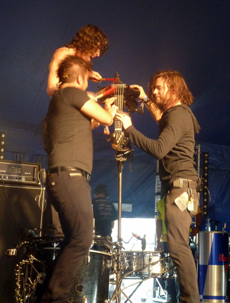 Three of Nothing More playing the bass Download Festival 2014